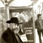 Man in a bus shelter